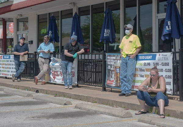 A line outside an unemployment office in Fayetteville, Ark., in April.